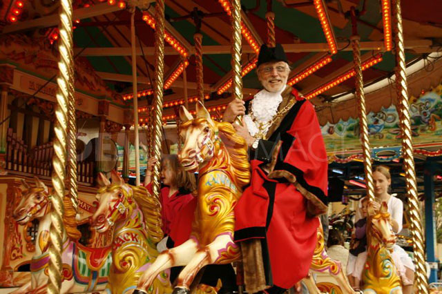 Image of the mayor riding the gallopers at the opening of Oxford St Giles Fair